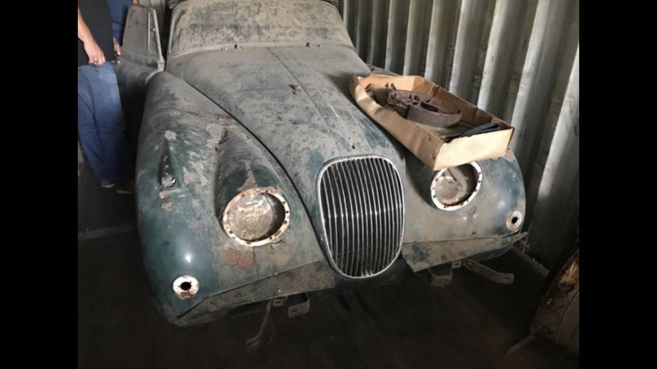 Jaguar XK 150 3.8 SE DHC - As found in container after 40 years! - it had been resprayed green but cream still showing where indicators removed